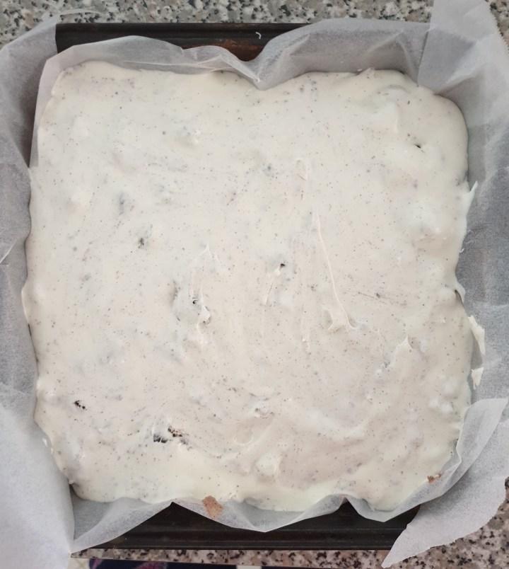 Oreo cheesecake in a baking pan.