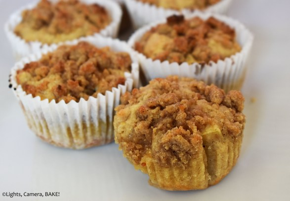 Apple cinnamon crumb muffin on a white plate.