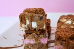 Slice of Biscoff rocky road with a pink background.