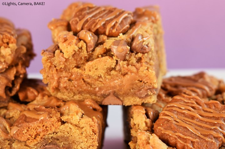 Cookie butter cookie bars on a purple background.