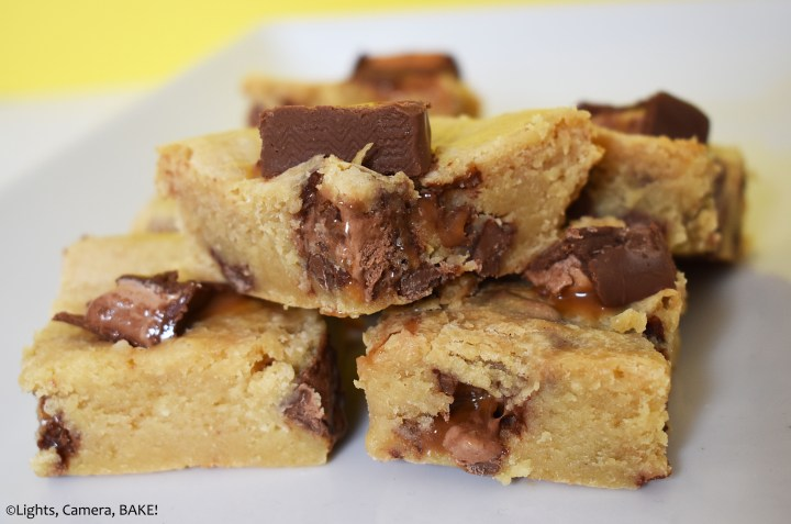 Stack of Mars bar condensed milk blondies on a white plate.