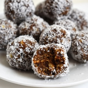 Maple almond bliss balls on a plate.