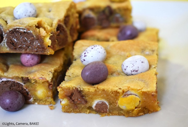 Easter Egg filled cookie bars on a white plate.