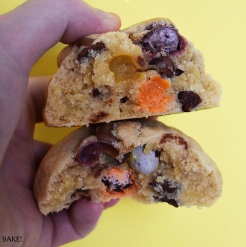 Mini egg cookie on a hand.