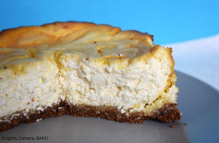 Lemon curd cheesecake on a plate.