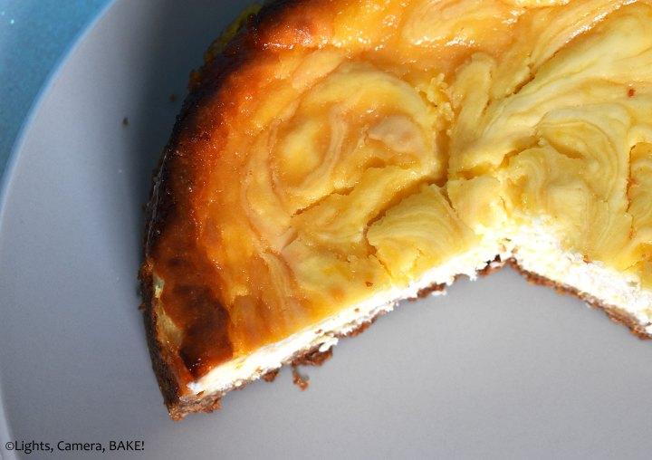 Lemon curd swirled cheesecake on a plate.