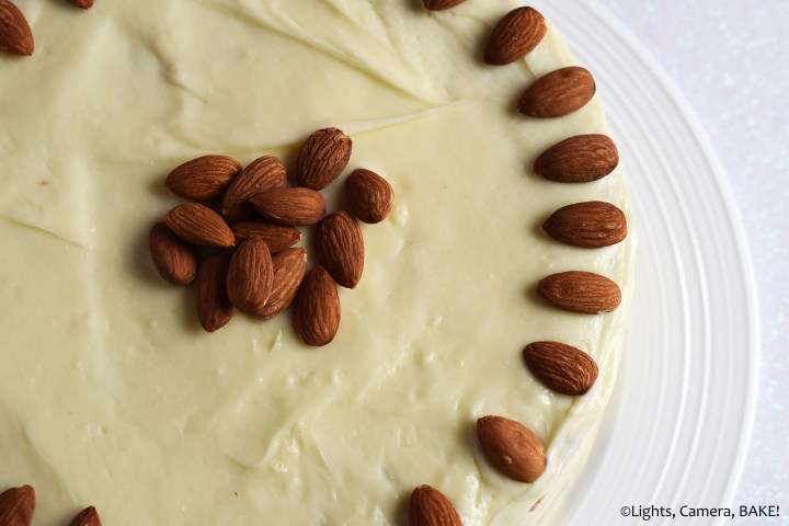 Almonds on top of a carrot cake.