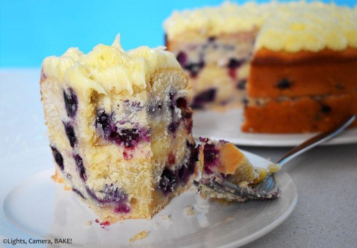 Lemon and blueberry cake on a blue background.