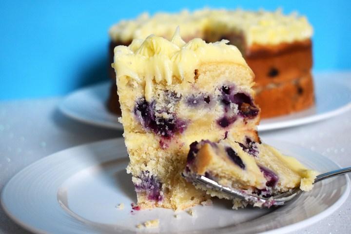 Lemon blueberry cake on a blue background.