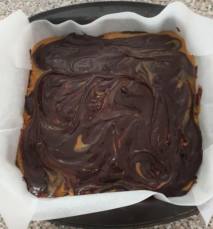 Caramel brownie batter in a baking pan.