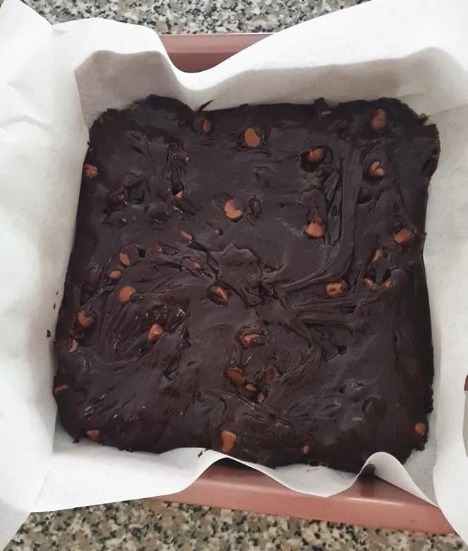 Brownie batter in a baking pan.