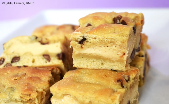 Slices of caramilok cheesecake cookie bars on a plate.