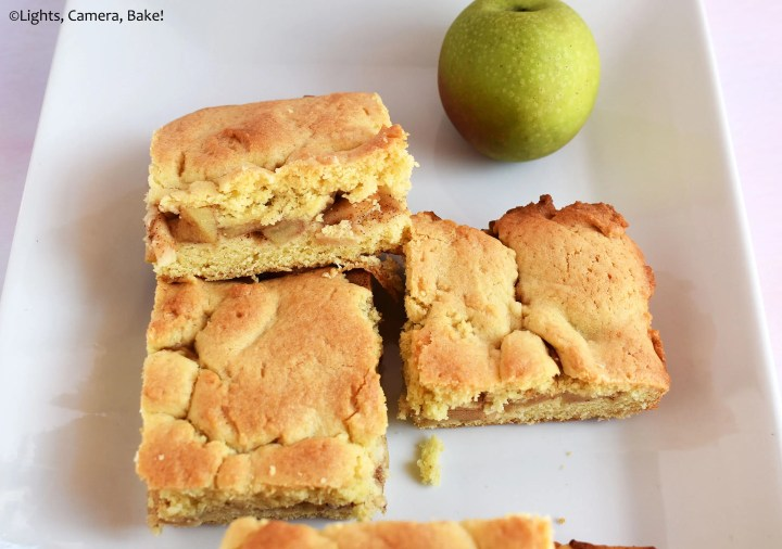 Apple and pieces of apple shortcake on a plate.