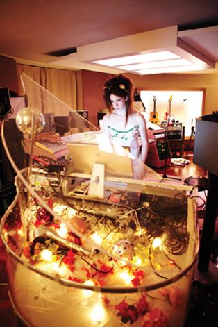 Imogen Heap in her home studio - note the sky above