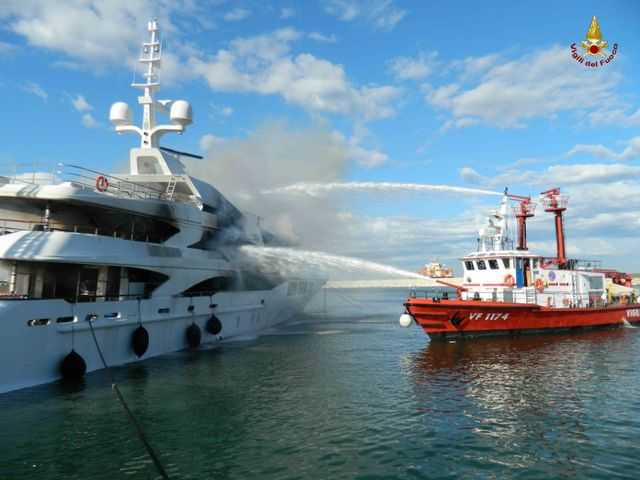 Firefighters-extinguishing-fire-aboard-FB261-superyacht-by-Benetti-