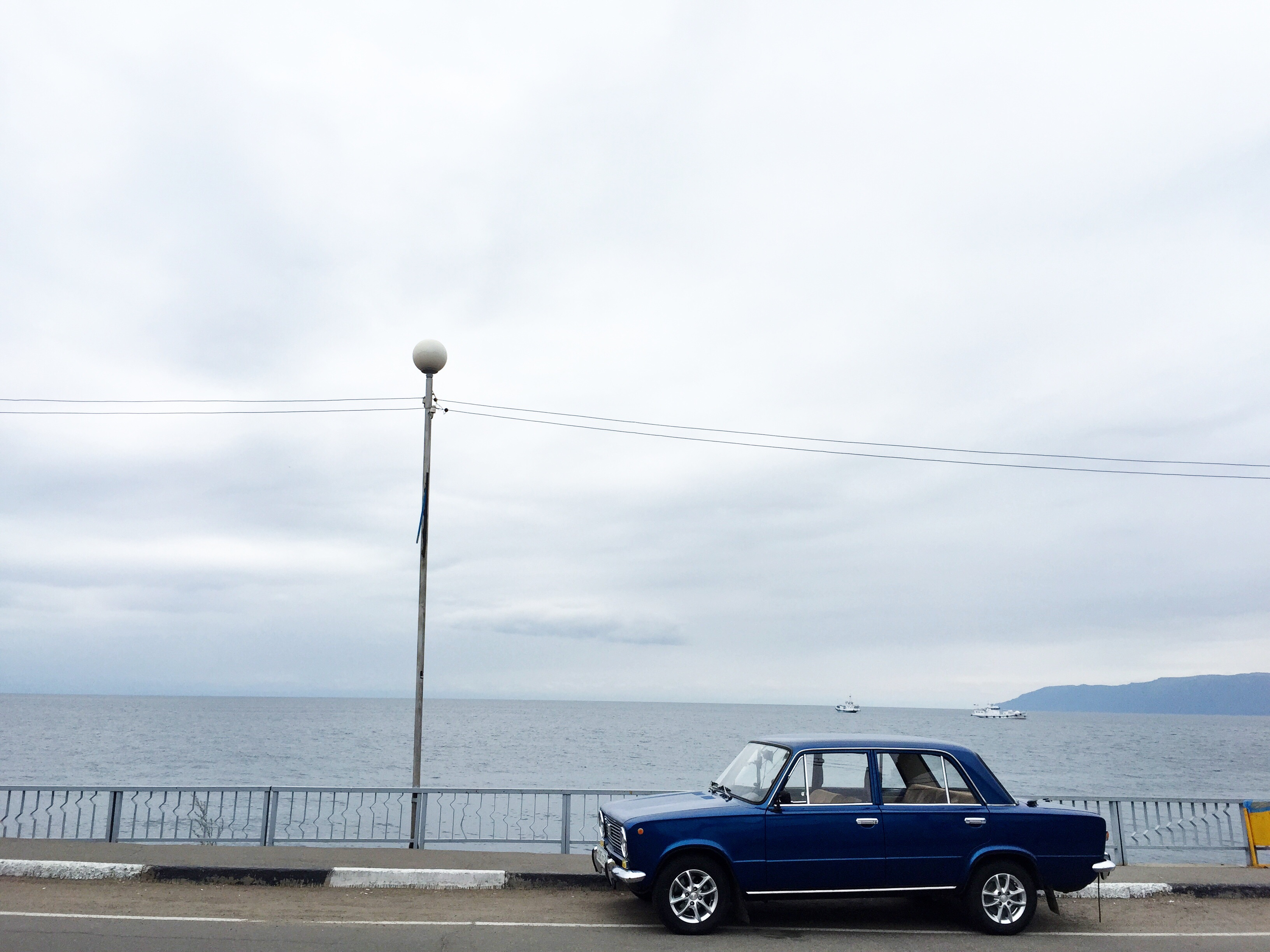 We spotted this absolutely gorgeous car as we were coming down the hill from the hotel. Against the lake it was especially spectacular.