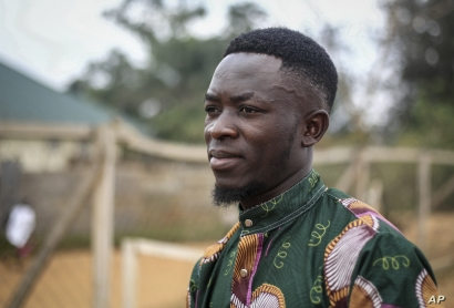 Motorcycle taxi driver Germain Kalubenge is photographed at an Ebola transit center where potential cases are evaluated, in…