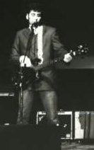 Fake rock star with fake Gibson