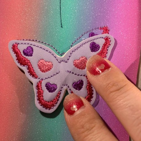 Lay the butterfly feltie on top, lining it up carefully