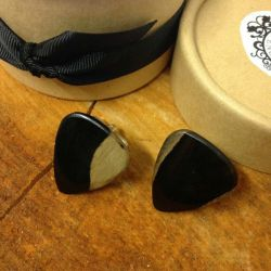 Close up image of Lilly Dilly's bespoke guitar plectrum cufflinks
