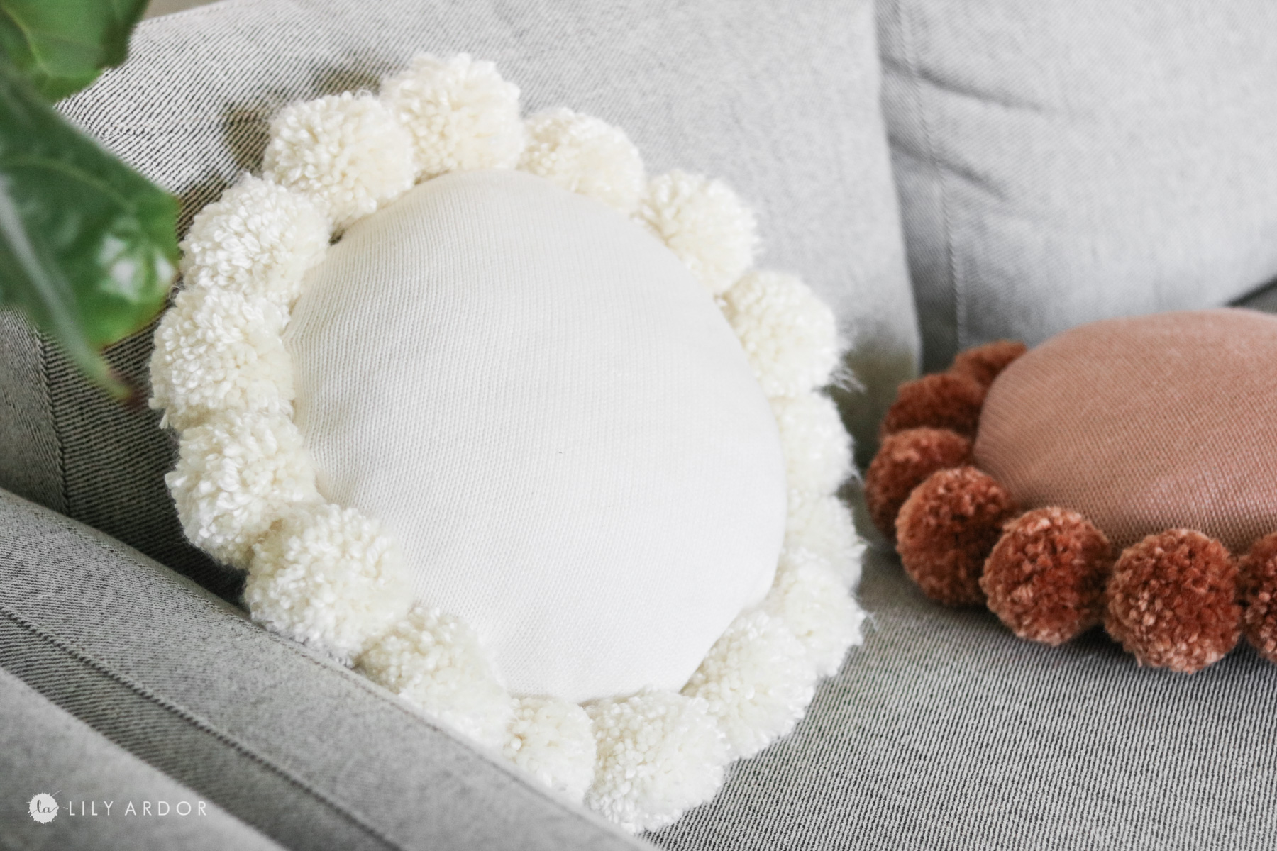 diy round throw pillow with pom poms