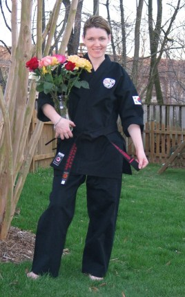 A pic of me, just after my black belt test many years ago. The flowers aren't lilies, but they're still gorgeous, don't you think?