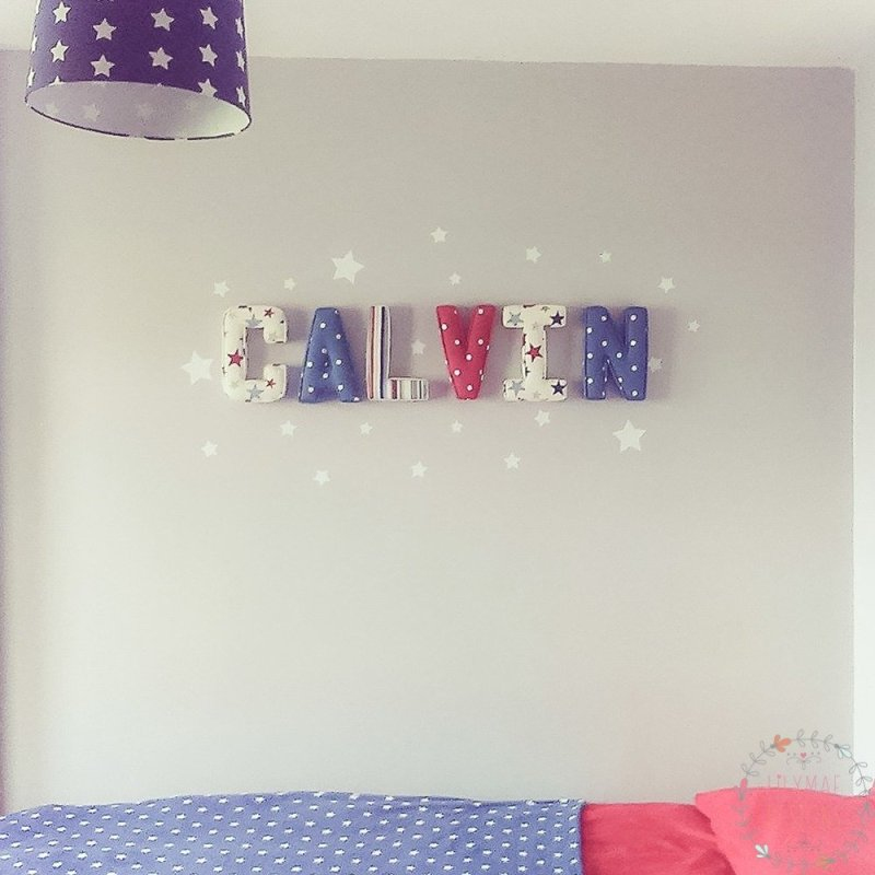 ★ Lilymae Designs ★ We offer many items including Fabric Letters, Extra Large Fabric Letters in sizes 22cm tall, 25cm tall, 30cm tall, 40cm tall, 50cm tall and 60cm tall., Fabric Hearts, Butterflies, Stars, Birds, Bunting, Memo Boards, Extra Large Memo Boards, Cushions, Lampshades, Curtains and Roman Blinds Available in any of our Clarke and Clarke and Prestigious Textiles fabrics. Custom fabric letter sizes available on request. Our Extra large fabric letters make great nursery decor, wall decor and home decor in any room. Also great gifts, new baby gift, new baby present baby shower gift baby shower present christening gift christening present little brother little sister niece nephew grandson godson granddaughter goddaughter first birthday gift first birthday present childrens birthday present childrens birthday gift new home gift new home present teacher gift teacher present dinner party gift dinner party present mum present mum gift sister gift sister present first home gift first home present wedding gift wedding present personalised gift personalised present best friends present best friend gift baby boy gift baby girl gift baby boy present baby girl present wedding gift wedding present flowergirl gift flowergirl present page boy gift page boy present bridesmaid present bridesmaid gift rainbow baby gift baby after loss gift tommys charity stillbirth awareness mothers day gift mothers day present mum gift mum present Personalised, handmade and made to order here within the UK Extra Large Fabric Letter Name Sets Calvin Fabric Letters with White Vinyl Star Stickers