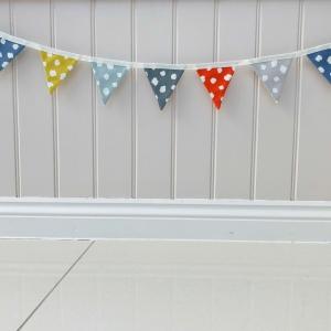 Handmade fabric wall Bunting in dotty yellow, citrus, mineral, blue, denim, smoke grey, charcoal Clio fabrics Studio G Clarke & Clarke Lilymae Designs