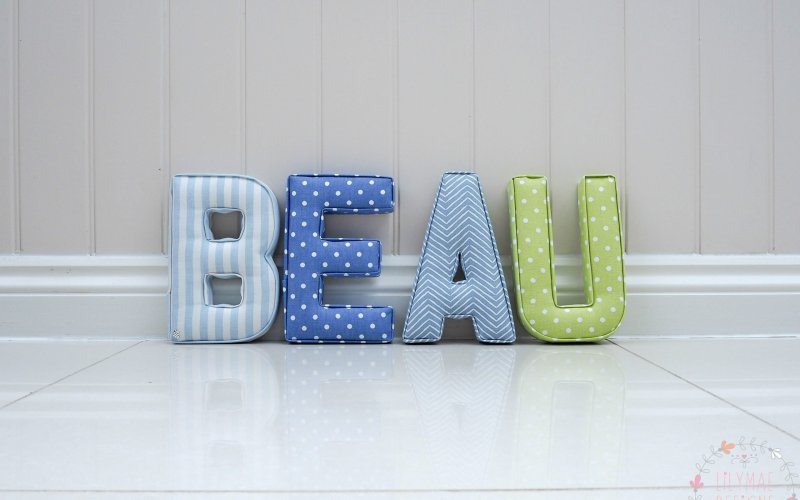 blue and green fabric wall initial letters lime green dark blue nursery theme for boy