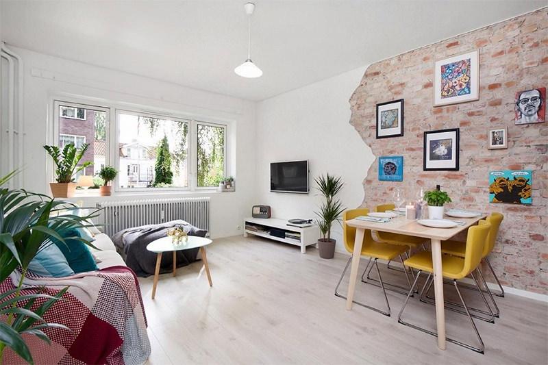 Apartamento de um quarto com parede de tijolinho