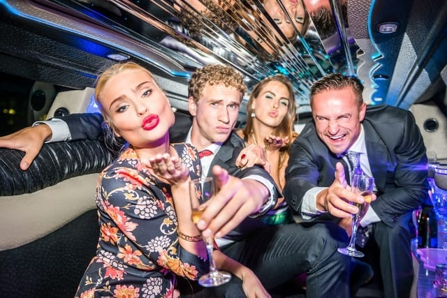 two couples having fun in luxury stretch limousine of Limo Hire Melbourne