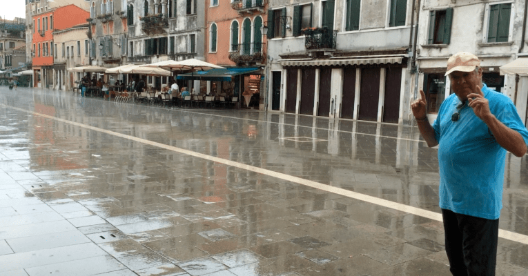 An old Venetian in the rain near the Arsenale in Venice