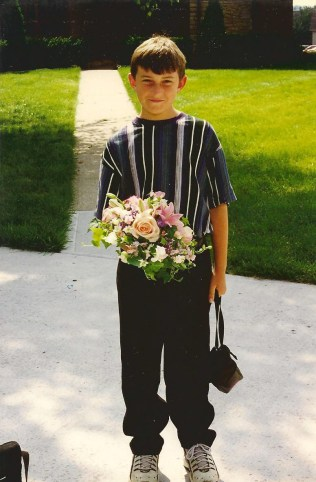 And my favorite wedding photo - here is my nephew, none too pleased to be holding his mother's flowers - so cute!