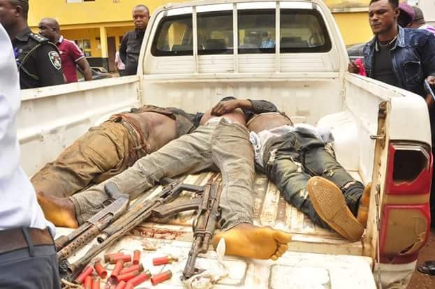 Police parade corpses of three armed robbers killed during foiled bank robbery attack in Edo
