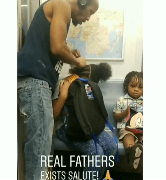 Dad melts hearts after video of him fixing his daughters' hair inside a moving train goes viral