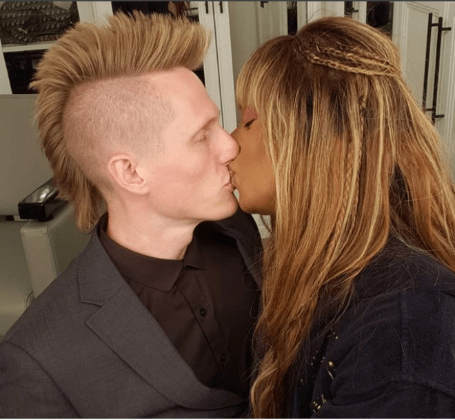 Transgender actress Laverne Cox celebrates her man with a kiss on National boyfriend Day