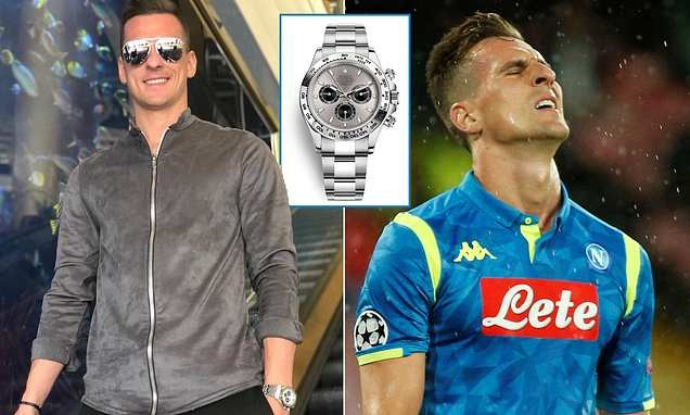 Napoli striker Arkadiusz Milik robbed at gunpoint and has 18,000 Rolex stolen on way home after Liverpool game