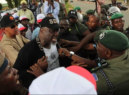 Caption this photo of Senator Dino Melaye during his clash with the Nigerian police during the PDP protest today