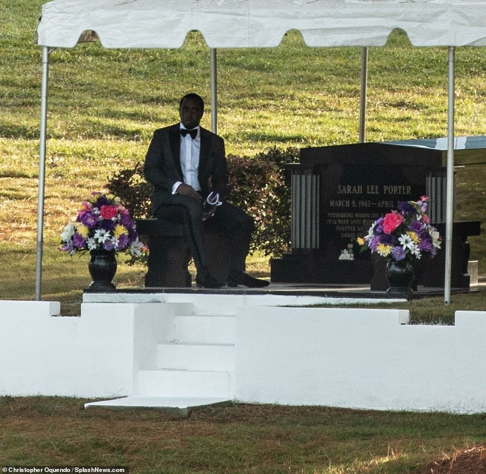 Heartbroken Diddy is pictured sitting alone by Kim Porter's gravesite ahead of her burial in Georgia (Photos)