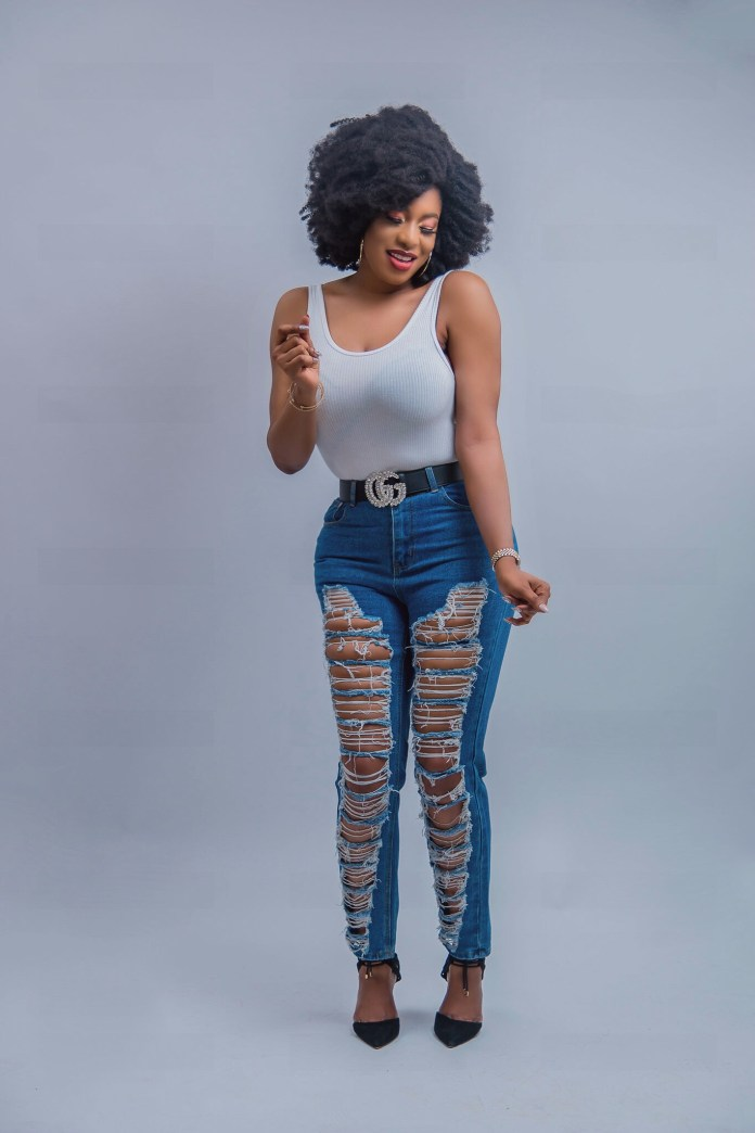 Chika Ike shares new photos rocking a new afro look and ripped jeans
