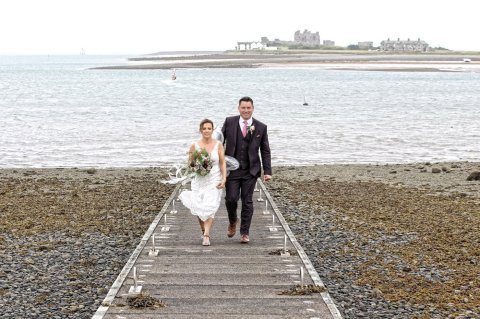 Photos: Bride, Groom and Wedding Guest Wear Raincoats to Protect their Outfits For the Coastal Ceremony