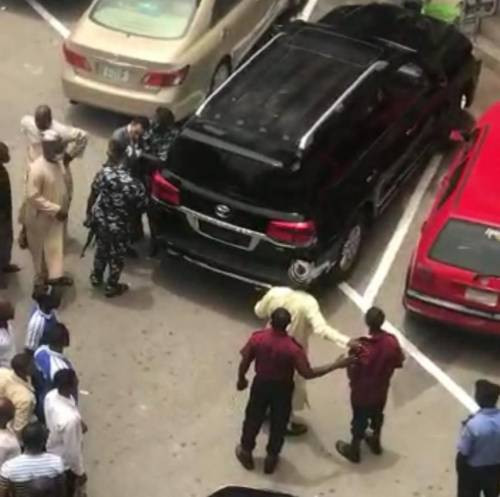 Moment Code of Conduct Tribunal Chairman was almost mobbed for assaulting  a security guard at Abuja Plaza