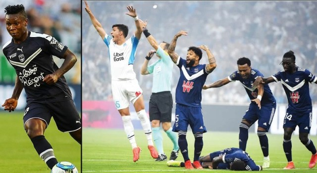 Bordeaux and Marseille players form a human shield around Samuel Kalu after the Super Eagles star collapsed on the pitch