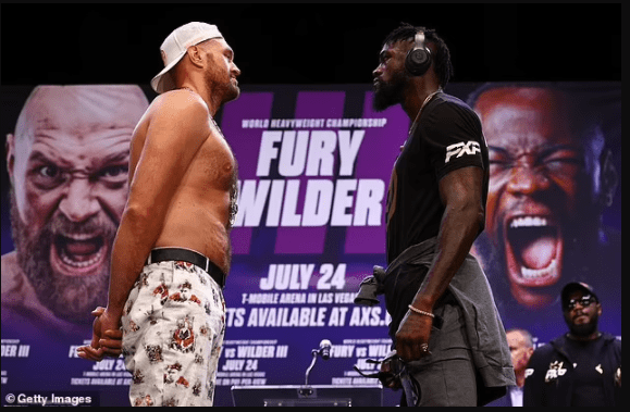 He should 'burn in hell' - Deontay Wilder says as he accuses Tyson Furyof 'sickening' lie about having Covid-19 to get their trilogy fight postponed