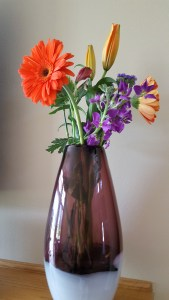 Vase adorns fireplace ledge. It from consignment shop.