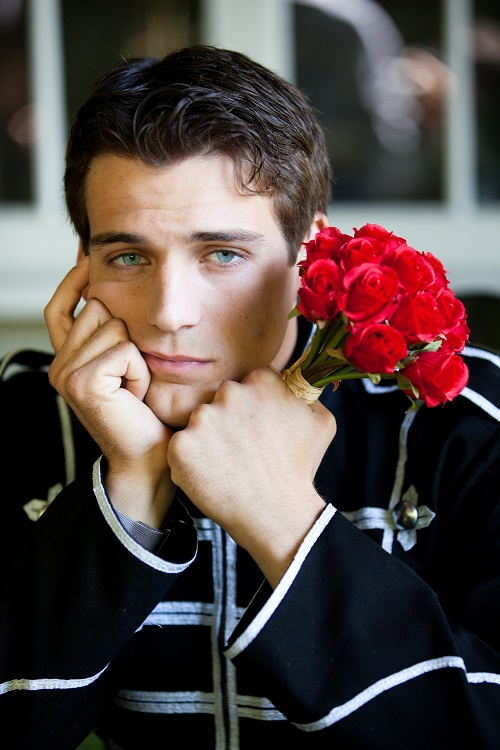 Handsome man with roses