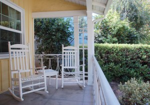 Feng Shui porch/ Feng Shui Patio. Yellow front porch with two rocking chairs.