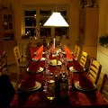 family dining table illuminated by pendant lamp