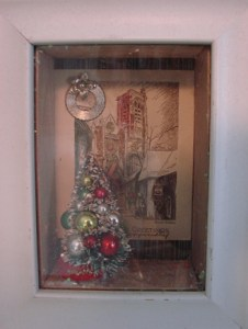 framed shadow box with christmas mementos.