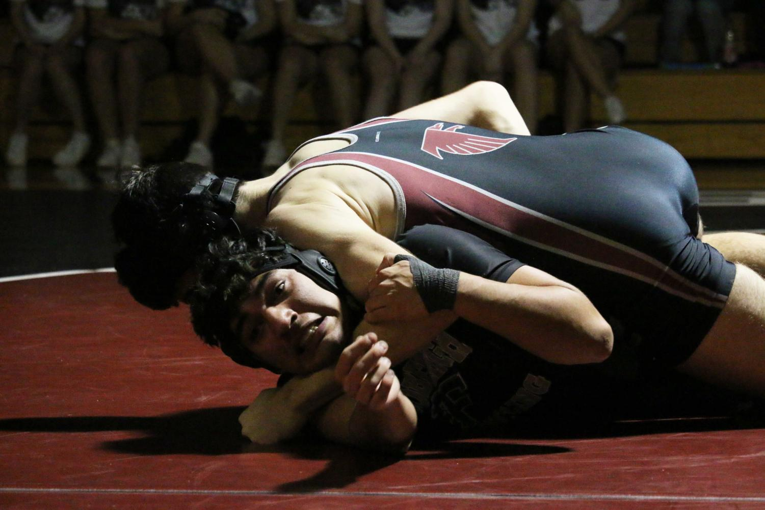 Manuel Ordonez-Webb (11) faces defeat against his opponent from Rockwood Summit.
